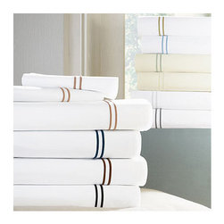"""Frontgate - Grande Hotel Flat Sheet - 100% Italian-spun Egyptian Cotton Percale. Generously sized to accommodate pillow-top mattresses up to 17"""" deep. Styled after sheets that grace the beds of some of the finest hotels in the world. Machine wash warm on gentle cycle using non-chlorine bleach as needed; wash dark colors separately. Tumble dry on low setting until slightly damp. If you want to recreate the sleep experience of a 5-star hotel, start with the SFERRA Grande Hotel Bedding Collection. Crisp white or ivory linens are framed in tailored, double rows of satin stitching. Woven to a 200 thread-count by master Italian weavers to last through wash after wash.  .  .  .  .  . For best results, pressing is recommended . Fitted sheet in plain white or ivory. Made in Italy by SFERRA. Part of the SFERRA Grande Hotel Bedding Collection."""