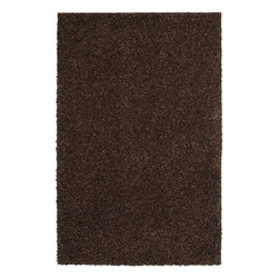 Mohawk Home - Mohawk Loft Kodiak Brown Shag Solid 5' x 8' Rug (6546) - Add an element of trend and style to your floor. These printed rugs are as vibrant as they are durable. Through cutting-edge manufacturing and innovation, these rugs are stain and fade resistant. For decades, Mohawk has been dedicated to making superior quality area and accent rugs that are manufactured right here in the United States.  Packed with performance our machine made rugs pair durability and stain resistance with stunning design and quality. In addition to their beauty and durability, the rugs are made from superior materials, blending the right colors, textures and patterns to express your personal style.