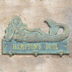 Frontgate - Personalized Mermaid Hook Plaque - Vintage Bronze/Verdigris or Bronze/Gold finish. Suitable for wet conditions, indoors or out. Add a splash of function and charm to a poolside patio or pool house. Our Personalized Mermaid Hook Plaque offers ample space to christen the space with your name, plus three hooks for hanging damp towels. The rust-resistant cast aluminum has a powdercoat finish for all-weather durability.  .  . Made in USA.