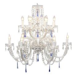 The Gallery - Authentic All-Crystal Chandelier with Blue Crystals - There's a secret to infusing instant sophistication into your room, a crystal chandelier. This showstopper takes glamour to a new level with stunning blue crystals integrated into an already spectacular design.