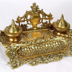AA Importing - Double Inkwell in Light Brass Finish - A brass finish highlights the ornate base of this traditional double inkwell stand. It's an exquisite writing desk accessory that collectors will love. The backsplash features a center medallion along with a detailed crest. Anyone who enjoys fine writing will appreciate this piece. 14.5 in. L x 8 in. W x 6 in. H