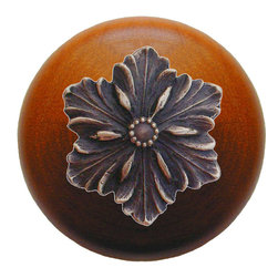 "Inviting Home - Opulent Flower Cherry Wood Knob (antique solid bronze) - Opulent Flower Cherry Wood Knob with hand-cast antique solid bronze insert; 1-1/2"" diameter Product Specification: Made in the USA. Fine-art foundry hand-pours and hand finished hardware knobs and pulls using Old World methods. Lifetime guaranteed against flaws in craftsmanship. Exceptional clarity of details and depth of relief. All knobs and pulls are hand cast from solid fine pewter or solid bronze. The term antique refers to special methods of treating metal so there is contrast between relief and recessed areas. Knobs and Pulls are lacquered to protect the finish. Alternate finishes are available. Detailed Description: The Opulent Scroll pulls add an amazing focus to any drawers or cabinets - it will make them look regal and majestic. The absolute perfect place for these pulls to be used is in the dining room on your china closet. They are great pulls to use if you are trying to punch up an antique piece of furniture or cabinet. You should consider using the Opulent Scroll pulls in combination with the Opulent Flower knobs or wood knobs with flower."