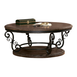 "Homelegance - Homelegance Harman Heights Round Cocktail Table with Metal Base - Substantial in size, the Harman Heights collection is a bold addition to a traditional room setting. Metal scroll work supports the elegantly adorned tables. A 48"" round Cocktail table is the focal point of this elegant table grouping."