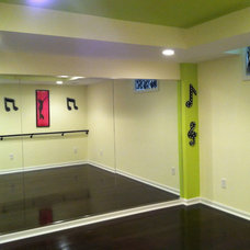Contemporary Basement by Tower Creek Construction