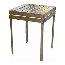 """Ortofrutta collection """"wooden"""" table - At first glance you would never know this table is cast aluminum rather than wood. The painstaking process creates a natural look out of a not so organic feeling material. I love the feel that the table top has been cut from a crate. Raw but polished."""
