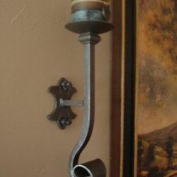 Hand Forged Candles Sconces - A pair of hand forged wrought iron candles sconces flank a painting bringing more interest and appeal to this wall, by adding interests through quality and craftsmanship of handmade and hand finished wall candle holders.