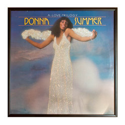 """Glittered Donna Summer A Love Trilogy Album - Glittered record album. Album is framed in a black 12x12"""" square frame with front and back cover and clips holding the record in place on the back. Album covers are original vintage covers."""