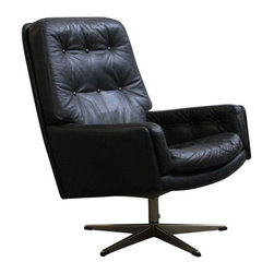 Danish Tufted Leather Vintage Swivel Lounge Chair - Everyone will know who's boss when you're sitting in this commanding chair. This Mid-Century Modern leather swivel chair features tufted arms, seat and back cushion. Made in Denmark.