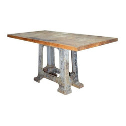 Used Vintage Solid Maplewood Table - This vintage solid maple wood table top sits on a iron cast base. It has a great industrial feel and age worn patina. Would look stunning paired with sleek, modern dining chairs!