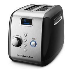 KitchenAid - KitchenAid KMT223 2 Slice Digital Motorized Toaster - Onyx Black - KMT223OB - Shop for Toasters from Hayneedle.com! If you thought the toaster couldn't be improved the KitchenAid KMT223 2 Slice Digital Motorized Toaster - Onyx Black has done just that. This toaster lets you toast to your preference with several options: keep warm bagel defrost reheat and toast/cancel. It also features a one-touch lift control that keeps your toast right where it belongs and an adjustable shading control that regulates the color of your toast.About KitchenAidFor over 80 years KitchenAid has been devoted to creating innovative cookware that inspires culinary excellence. From the original Stand Mixer first created in Troy Ohio this industry leader now offers a wide assortment of cookware bakeware kitchen accessories and appliances. All products are designed with your cooking needs in mind and are engineered to exceed the highest manufacturing standards. Since 1919 KitchenAid has been synonymous with quality and value. As a result all KitchenAid products are backed by exceptional industry-leading warranties. Check out the complete line today.