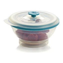 """Collapse It 2 Cup - Food storage containers that do it all. Microwave your lunch, bake up a meal or freeze your leftovers. Unique design means every size collapses to a mere 1.25"""" for portability and slim storage. Naturally BPA-free silicone containers and lids are color-coordinated for quick pairing, and the easy-pull lids are vented to release steam slowly during cooking."""