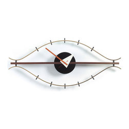 Vitra - Nelson Eye Clock | Design Public - You have your eye on the prize no matter what time it is, right? Here's a prize clock for your collection. It's an iconic George Nelson design, sculpted in brown metal with red, black and white clock workings.  It's a sure way to add classic style and colorful whimsy to your wall.