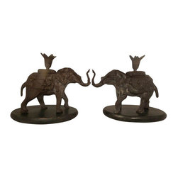 Pre-owned Elephant Candle Holders - A Pair - A pair of elephant candleholders with faux-marble bases. Elephants are made of dark gray metal. These decorative candleholders will look great displayed on a console or shelf or in use holding lit candles, setting the mood!