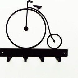 Oh Wheely Key Rack - Hang your keys in style on a handmade key rack that suits your personality. Cyclists and vintage enthusiasts will love this one adorned with the whimsical lines of an antique penny farthing bicycle. Its sturdy black steel construction gives you four spots for keys and suits nearly any personal style.
