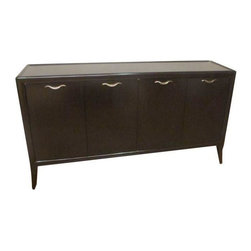 """Pre-owned Thomas Moser Sabina Buffet - MoserForm - This piece has great Art Nouveau styling. Made of Black walnut with four doors and two tray drawers, two adjustable shelves in an Espresso finish. The soft, subtle elegance of this piece belies its capacity to serve and store. Four doors of matched figured walnut are interrupted only by delicate forged brass pulls reflecting """"silk on the wind"""". Behind doors find two tray drawers, one offering a silver storage, open storage with 2 adjustable shelves. Please note that there is one small nick in the finish."""