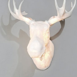 Northern Lighting - Moo wall sconce - The Moo wall sconce is a full scale wall-mounted Norwegian light moose head. Moo may be used both for indoor and outdoor decoration purposes. The figuratively shaped lamp body is made of poly-resin material, which gives a smooth and transparent flow of light. The bulbs placed inside the horns add an extra element of soft, sparkling and translucent light effect to the lamp.