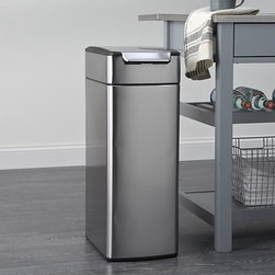 simplehuman® 10.5-Gallon Slim Touch-Bar Trash Can - Fingerprint-proof, stainless-steel can with a slim, space-saving design features a unique touch-bar system that opens easily from any angle with a simple nudge or tap with your elbow, hip or knee. The lid remains open at your discretion, making it convenient for food prep and plate scraping. The sleek, specially designed hinge moves out of the way for the widest possible opening. Lid lifts off easily for a quick bag change. Protective nylon discs on the base prevent scratching floor surfaces.