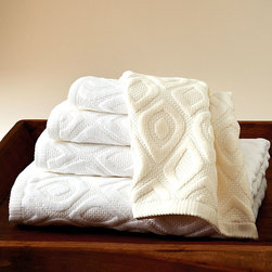 Astoria Towel - Unadorned tone-on-tone graphics � a transitional rethinking of a peacock-feather design � gain drama from their repeated placement and their smooth dimension above the textured base of the Astoria Towel.  Enjoy the traditional splendor of plush towels paired with the absorbency of woven-in texture; these visually stunning neutral bath towels reverse to a classic terry.
