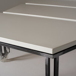 Vanguard white porcelain table - White porcelain enamel topped table with satin steel base on casters.
