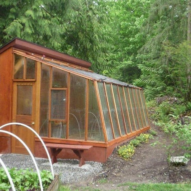 Solite greenhouse kits - 9 1/2 x 16 Solite Lean to greenhouse,   Redwood frame.  Attached to a small shed-type building.