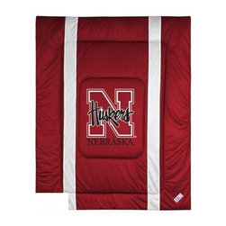 Sports Coverage - Nebraska Huskers Bedding - NCAA Sidelines Comforter - Full - Show your team spirit with this great looking officially licensed Nebraska Huskers comforter which comes in new design with sidelines. This comforter is made from 100% Polyester Jersey Mesh - just like what the players wear. The fill is 100% Polyester batting for warmth and comfort. Featuring authentic Nebraska Huskers team colors, each comforter has the authentic Nebraska Huskers logo screen printed in the center. Soft but durable. Machine washable in cold water. Tumble dry in low heat. Covers are 100% Polyester Jersey top side and Poly/Cotton bottom side. Each comforter has the team logo centered on solid background in team colors. 5.5 oz. Bonded polyester batts. Looks and feels like a real jersey!