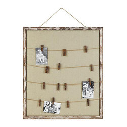 Woodsy Picture Holder - Another way to personalize your guest's stay? Add photos or mementos to this picture holder. Its distressed wood frame and rustic elements give it a homey, heirloom feel.