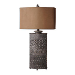 Uttermost - Shakia Distressed Bronze Rustic Table Lamp - This  rustic  table  lamp  has  a  distressed  bronze  finish  over  embossed  details  on  a  metal  base.  The  rusty  brown  shade  is  oval  with  straight  sides.  This  rugged  lamp  is  great  for  any  rustic-contemporary  decor.  Click  here  to  see  all  of  the  lamps  we  offer.
