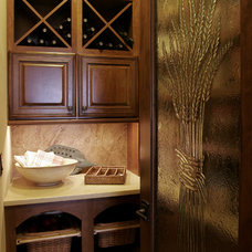 Traditional Wine Cellar by Architectural Designs