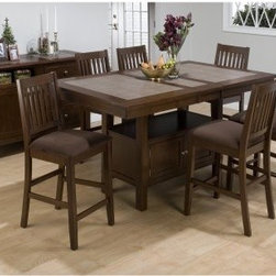 Jofran Trumbull 7 Piece Counter Height Dining Table Set with Optional Server - Make every meal a memory when you dine at the Trumbull 7 pc. Counter Height Dining Table Set with Optional Server. With 6 chairs a round table and an option of including the dining server this set is definitely the complete package. Every piece is made of premium Asian hardwood material and has a rich brown finish. The table features a storage base and tile top while the chairs have a faux leather cushion and wee back design. Additional Information Chair Dimensions: 19W x 21D x 41H inches Table Dimensions: 48L x 48W x 36H inches Server Dimensions: 52L x 18W x 36H inches About Jofran FurnitureJofran is a seller of fine home furnishings based in Norfolk Mass. Launched In 1986 Jofran is known for the high-quality materials and meticulous methods that go into producing its products. Jofran furniture is easy-to-assemble and includes various styles from all around the world making it easy to find a piece that suits your home decor.