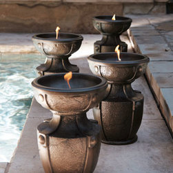 """Horchow - Fire Urn - Exclusively ours. A fire urn adds great ambiance to outdoor entertaining. Handcrafted of resin, styrene, and fiberglass, this lightweight urn is easy to move. Sold individually; each, 9.5""""Dia. x 13""""T, with a hand-painted bronze finish. Imported."""