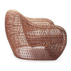 Balou Lounge Armchair | Janus et Cie - The airy Balou Lounge Armchair is made of rattan handwoven over a powdercoated steel frame. Requires a cushion. Product No. 757-15-111-02-00