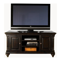 """Tommy Bahama Home - Harrington 60"""" TV Stand Entertainment Console, Deep Tamarind - Kingstown Collection. The relaxed traditional styling of Kingstown finds its inspiration in classic British Colonial design, with a hint of campaign and a touch of safari. Designs reflect the sense of a well traveled life, and items hand selected during journeys around the globe. At first glance, the rich Tamarind finish appears black, but offers glimpses of gold and crimson through its aged finish. Accents include hammered copper, leather clad silhouettes, and zebra patterned hair on hide. Experience the excitement of discovery with Kingstown from Tommy Bahama Home."""