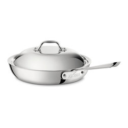 """All-Clad - All-Clad Stainless Steel 11"""" Nonstick French Skillet w/Lid - Sear, brown, pan fry, and baste everything from eggs to meat with the All-Clad Stainless Steel Nonstick 11-Inch French Skillet w/ Domed Lid. This pan's large surface area and rounded sides hold in heat and liquids while preventing splattering. The rounded sides also allow food to be easily tossed or turned with a nonstick-safe spatula. As with all cookware from All-Clad's Stainless Collection, this piece has a stick-resistant 18/10 stainless steel interior and bonded three-ply construction with an aluminum core to deliver even heating. The pan's long, riveted stick handle is comfortable to use and stays cool while the pan is in use. For Searing, Browning, Pan Frying, and Basting The large bottom and rounded sides of this nonstick 11-inch French Skillet w/ Domed Lid make it easy to toss food or to turn it with a spatula. The shape also helps to retain heat, prevent splattering, and develop your food's full flavor and color. The pan's cast and riveted stainless steel handle stays cool on the cooktop, so you can cook safely and comfortably. Durable Nonstick Coating The skillet's three-ply construction with aluminum core delivers even heating. The PFOA-free nonstick coating provides excellent release, and it's durable enough for dishwasher or oven use up to 500 degrees Fahrenheit. This skillet is compatible with all cooktops, including induction. Premium Stainless Steel Construction Classic design, high performance, and lifetime durability unite in the Stainless Collection, All-Clad's most popular line of cookware. Products in the collection feature an interior core of aluminum for even heating and a polished, 18/10 stainless steel exterior and cooking surface for fine culinary performance. All-Clad stainless steel cookware features an interior starburst finish for excellent stick resistance. The bottom of each pan is engraved with a convenient capacity marking."""