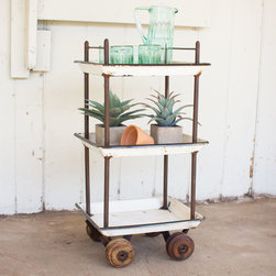 Gardener's Delight Bar Cart - So your garden needs some tending to. And you need a big pitcher of water to keep hydrated. Load your supplies on this chic bar cart to get your work done. And when you're finished? Dust it off and pile the drinks on it for a festive affair that evening with friends.