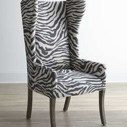 Kayla Zebra Print Wingback Chair - This crazy striped print plays well with the classic wingback design. This chair makes an everyday reading nook suddenly feel extra exotic.