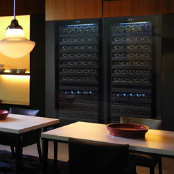Vinotemp - 2-Pc Touch Screen Wine Cooler Set - Floor standing. Made from glass and steel. Black color. Fits approximately 142 bottles. Includes one right hinges and one left hinges wine cooler. 23.5 in. W x 26.75 in. D x 69 in. H (249 lbs.). 3-5 days lead time. Security lock and key. Touch screen controls. Digital controller with blue LED readout. Dual-zone wine cooler with 15 sturdy pull-out metal shelves. Front exhaust allows the unit to be built-in or freestanding. Sleek and contemporary design. Warranty