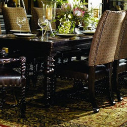 Tommy Bahama Home Kingstown Dining Collection - The relaxed traditional styling of Kingstown Collection finds its inspiration in classic British Colonial design, with a hint of campaign and a touch of safari. Designs reflect the sense of a well-traveled life, and items hand-selected during journeys around the globe. At first glance, the rich Tamarind finish appears black, but offers glimpses of gold and crimson through its aged finish. Accents include hammered copper, leather-clad silhouettes, and zebra-patterned hair-on-hide. Experience the excitement of discovery with Kingstown from Tommy Bahama Home.