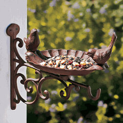 Iron Bird Feeder - I love this birdfeeder because I've never seen a cast iron one that attaches to the wall by hinges. On top of it, the clever design provides a hook where you can hang a plant, making the birds feel even better.