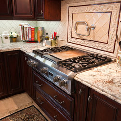 Kitchen - Dynasty by Omega cabinetry in the Marco door style, Cherry wood with a Burgundy finish and a Onyx glaze.