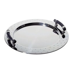 Alessi - Michael Graves Round Tray with Handles by Alessi - The Alessi Michael Graves Round Tray with Handles is the ideal piece with which to start off a playfully sophisticated Michael Graves collection. This modern serving tray is made out of Mirror Polished stainless steel, its clean lines accented by raised dots around the rim and curved Black PA handles.Alessi, known as the Italian design factory, has manufactured household products since 1921. The stylish and fun items offered are the result of contemporary partnerships with some of the world's best designers of unique and modern home accessories.The Alessi Michael Graves Oval Tray with Handles is available with the following:Details:Made of 18/10 stainless steelBlack PA (polyamide) handlesMirror Polished finishDesigned by Michael Graves, 1990Shipping:In Stock items ship within 1 business day. Others usually ship within 2 weeks unless otherwise noted.