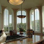 Kitchen Shutters - Arched kitchen plantation shutters in a breakfast room