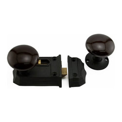 Cast Iron Privacy Rim Lock with Brown Porcelain Knobs - Cast iron construction and beveled edges highlight the Cast Iron Privacy Rim Lock with Brown Porcelain Knobs. A slide bolt is provided for extra privacy.