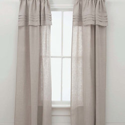 Pleated Linen Natural Window Panels - The translucence of a finely-woven natural linen comes together with the tailored look of pleating details and a full, formal drape to make the Pleated Linen Natural Window Panels both traditional and sophisticated.  The layered look of the built-in valance with its crisp folds contributes to a sense of classic luxury when you dress a window in this sumptuous but restrained drapery.