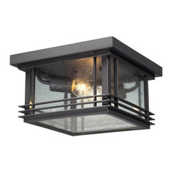 ELK Lighting - ELK Lighting Blackwell 42306/2 Outdoor Flushmount - Graphite - 11W in. - 42306/2 - Shop for Flush Mounts from Hayneedle.com! Provide a stylish and functional accent to your outdoor decor with the ELK Lighting Blackwell 42306/2 Outdoor Flushmount - Graphite - 11W in.. Its warm graphite finish complements its steel frame with clean lines and metal accented clear seedy glass shade. Two 60-watt bulbs (not included) provide ample light and help update your standard entryway into a welcoming contemporary one.About E.L.K. LightingIn 1983 Adolf Ebenstein Jonathan Lesko and Russell King combined their lighting expertise to form E.L.K. Lighting Inc. From the company's beginning in eastern Pennsylvania it has become a worldwide leader featuring manufacturing facilities and showrooms in the U.S. and abroad. Award-winning designs and state-of-the-art engineering give their lighting outstanding quality and value and has made E.L.K. the choice of such renowned places as the Historic Royal Palaces of England and George Vanderbilt's Biltmore Estates. Whether a unique custom design or one of their designer lines all products are supported by highly trained technical and customer service teams. A commitment to providing superior lighting products with unmatched customer satisfaction remains at the heart of the E.L.K. family tradition.Please note this product does not ship to Pennsylvania.