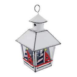 White Nautical Sailboat Mini Metal Tealight Lantern - This miniature metal tealight lantern can be displayed either hanging or sitting on a tabletop, making it a great little decor accent or part of a party centerpiece. The lantern is approximately 7 inches tall (not including the hanger), and measures 4 inches by 4 inches around the top. It is painted with a white enamel, has a distressed finish, and the sailboats are hand painted. The tealight holder is removable from the bottom and can accommodate up to 1 1/2 inch tealight candles. Use battery operated LED tealights for worry-free accent lighting that lasts all night. This lantern is a great accent in rooms, on porches, or at bars with beach or nautical themes.