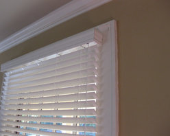 Fauxwood Blinds in Bungalow - This inexpensive cut-down line of blinds includes this great looking valance with every blind. Here, a nice compliment to the crown moulding!