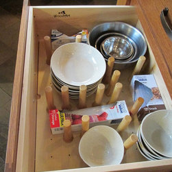Kitchen Accessories - Dish peg kits designed for deep drawers hold plateware and bowls in place while the drawer opens and closes.
