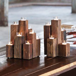 Forest Tea Light Pillars - Light up your space with the flickering elegance of tea lights. Crafted out of re-purposed Chinese Elm, the Forest Tea Light Pillars cluster candles together for an eye-catching display. Reminiscent of the forest itself, the Forest Tea Lights can be clustered together to create an artistic look for your space.
