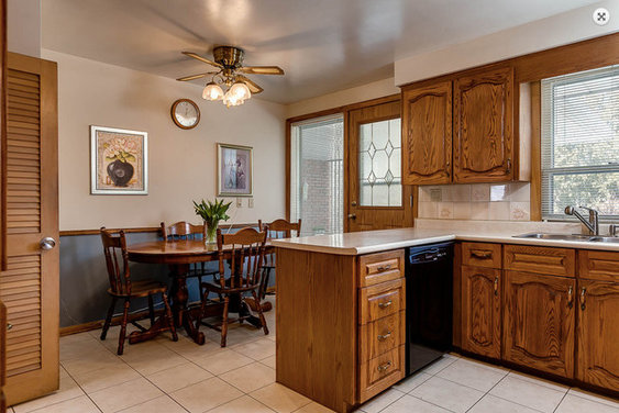 80 39 s oak kitchen needs short term paint facelift makeover for 80s style kitchen cabinets