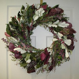 24 in. Mulberry Lane Eucalyptus Wreath - The 24-inch Mulberry Lane Eucalyptus Wreath is a lush ornament that pleases the senses. This wreath is a lovely addition to your doorway and may be hung indoors or outdoors if protected. It blends the soothing fragrance of eucalyptus with Salal for a natural base accented with cream and red silk flowers Leptofolia and Integrafolia branches for a combination of textures. This hanging wreath is 24 inches in diameter. A gorgeously scented welcome home!This product is designed for indoor use or outdoor use in a protected area. Direct exposure to sunlight and humidity over long periods of time will result in nominal fading. Also be careful when placing your wreath garland or swag over a heat source as high temperatures may result in damage. Follow these easy regulations and you'll have a maintenance-free product that adds plenty of seasonal charm.